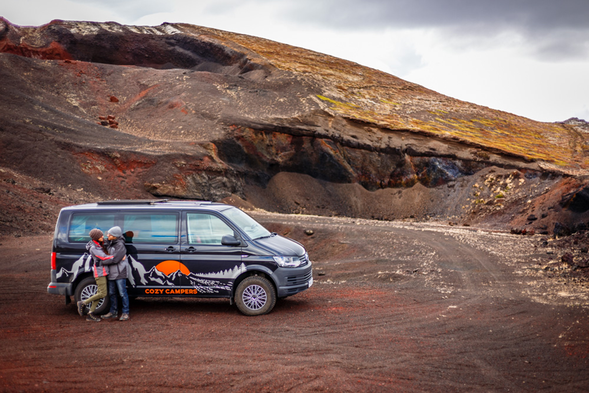 couple in front of camper in Iceland