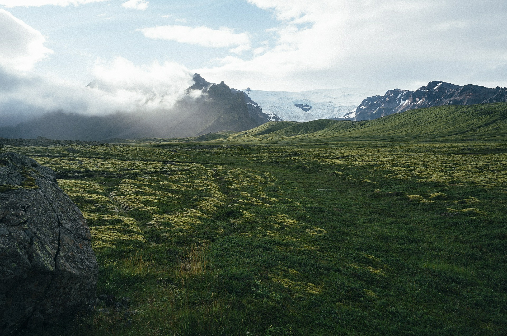 green valley with glacier in Iceland