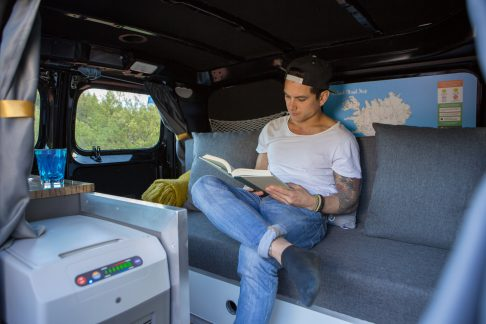 man sitting on couch in camper