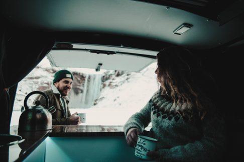 people inside a camper in winter