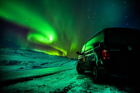 camper under Northern lights sky