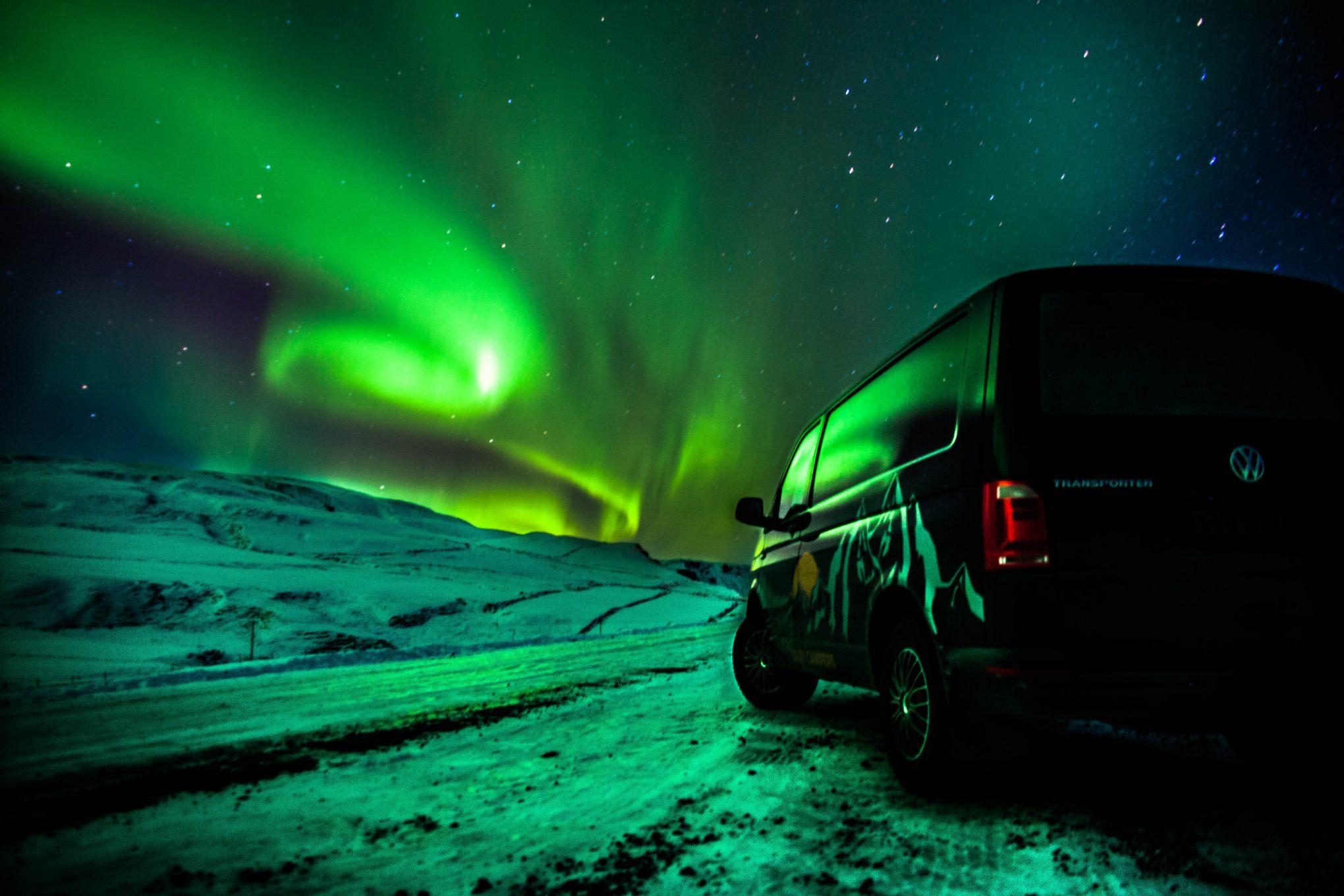 camper under Northern lights sky