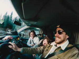 family in cockpit of campervan, renting a camper van