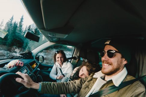 family in cockpit of campervan