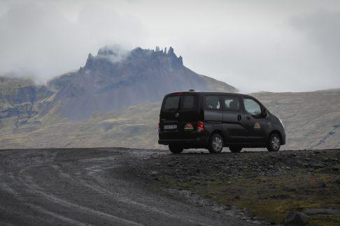 camper in rough lava landscape