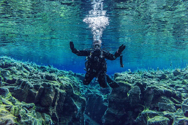 You can dive between continent in Iceland